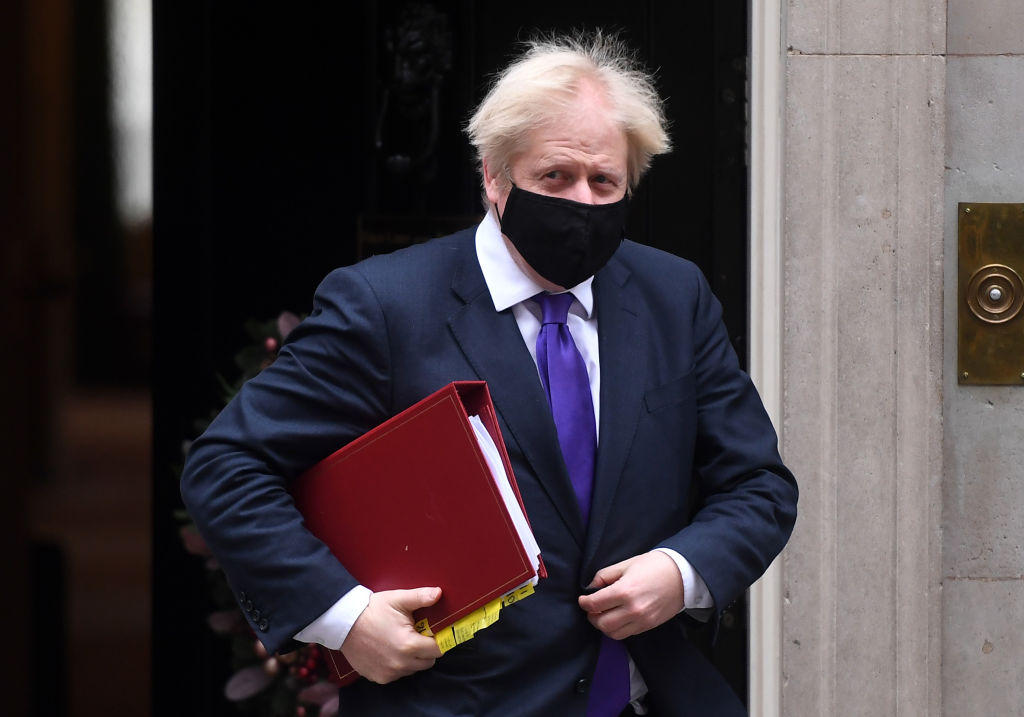 British Prime Minister Boris Johnson leaves 10 Downing Street after it was announced that the UK Government has approved the Pfizer/BioNTech Covid vaccine for use from next week, on December 2, 2020 in London, England.