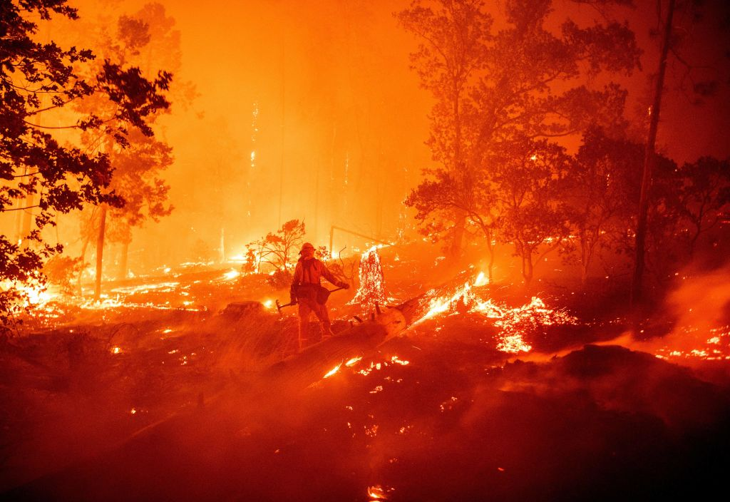A firefighter works the scene as flames push towards homes during the Creek fire in the Cascadel Woods area of unincorporated Madera County, California on September 7, 2020.