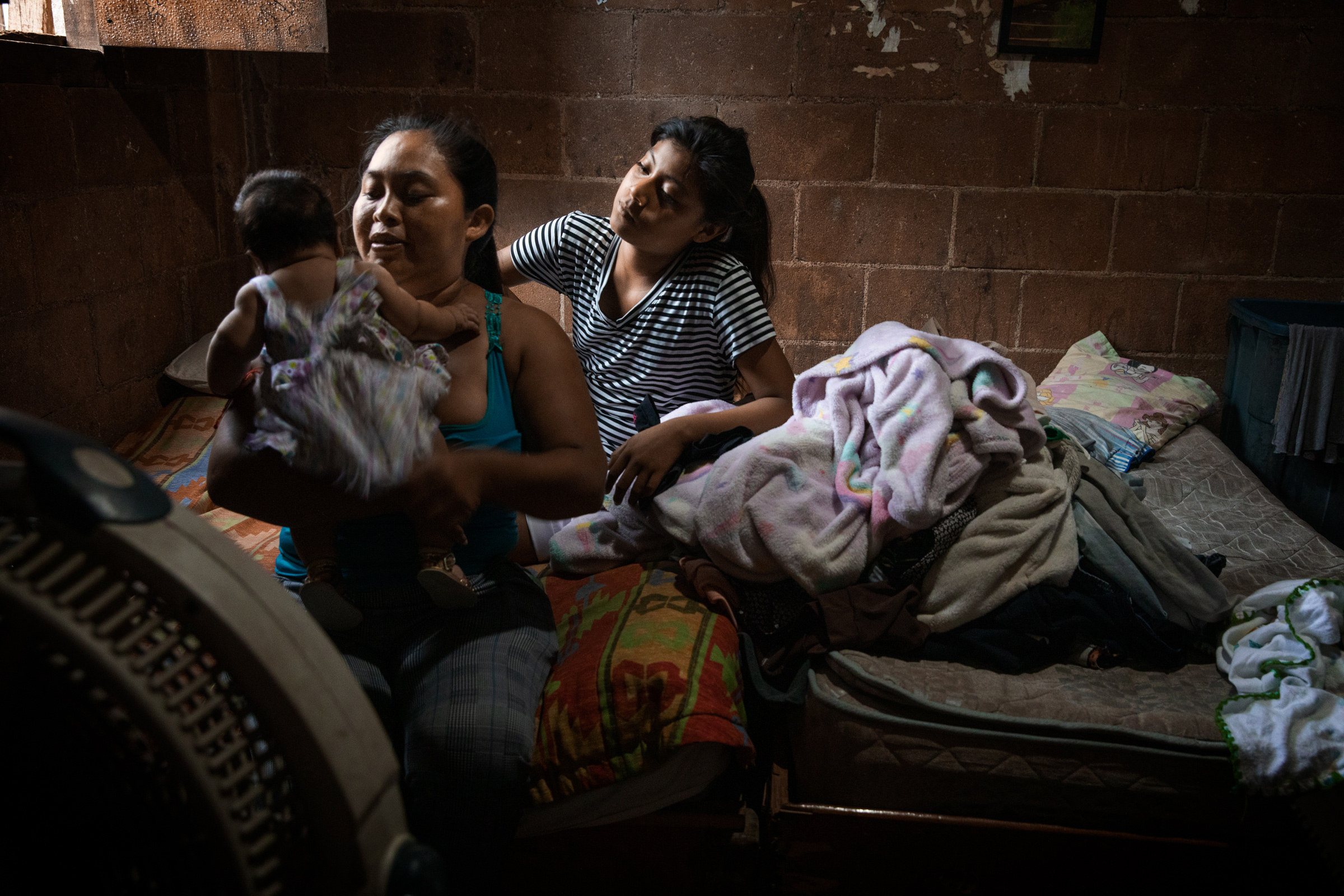 Heidi Hernandez, 29, and her sister Julisa, with Heidi's 2-month-old baby at home, in Tres Reyes, a shanty-town located on the outskirts of Cancún, on Oct. 16. Heidi's baby was due in the middle of the pandemic, but no midwife wanted to help her deliver at home, so Heidi ended up giving birth in the hospital, despite her fear of the virus.