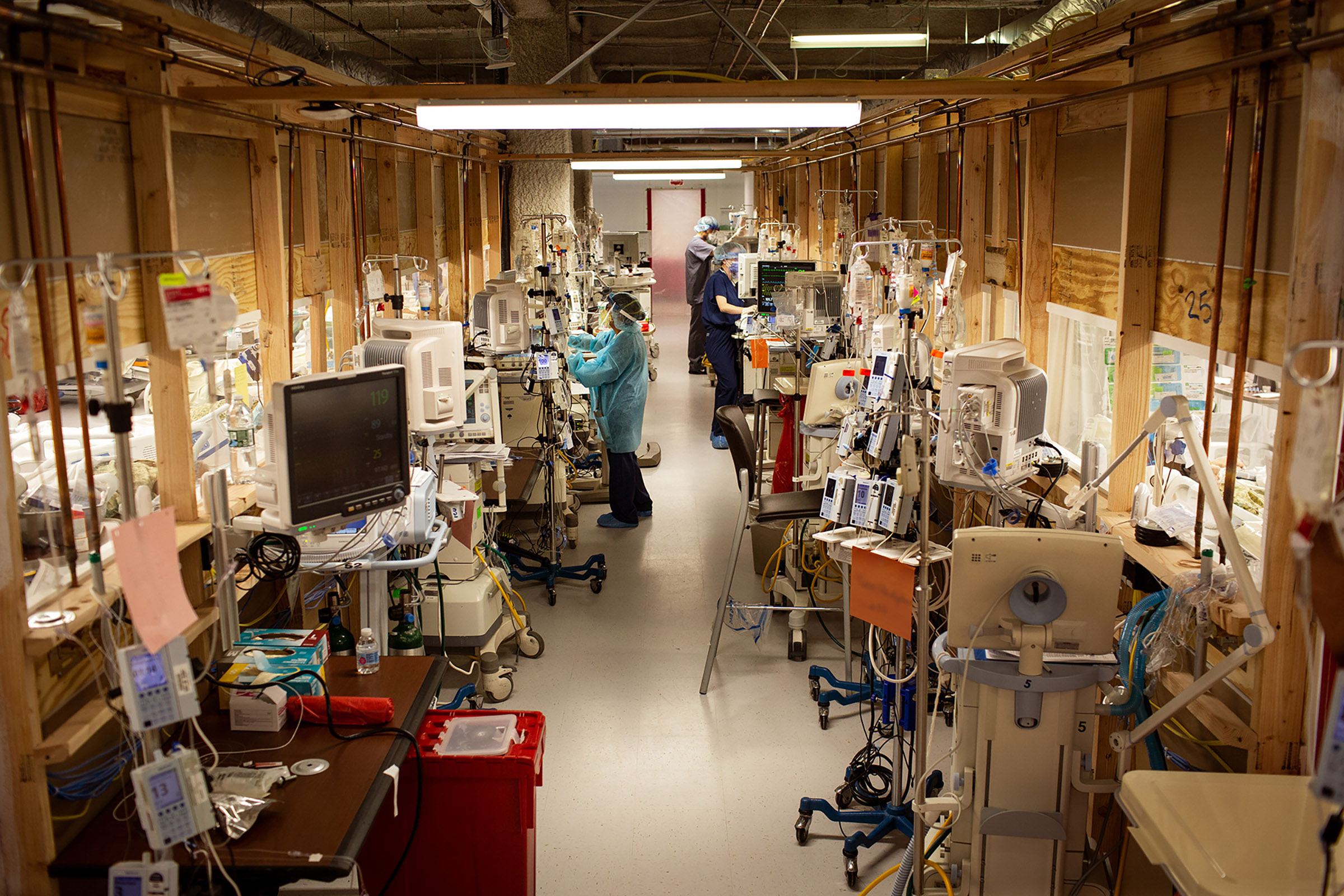 Moving the gear into the hall between the new units reduced PPE use from 20 or 30 per shift to five or six, the photographer said, at Holy Name Medical Center in Teaneck, N.J. (A small portion of this photograph is obscured to preserve the confidentiality of a patient's identity.)