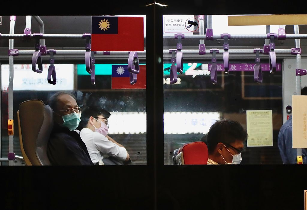 Passengers wear surgical masks on public transport in Taipei City, Taiwan, on 29 October 2020