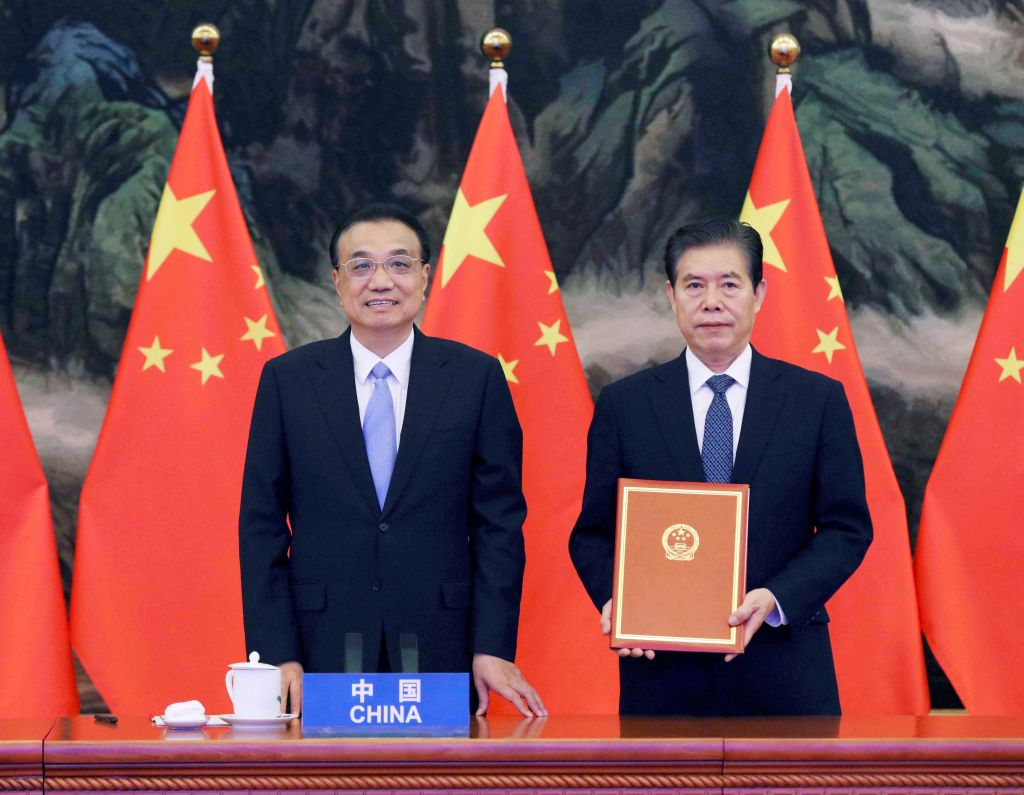 Chinese Premier Li Keqiang attends the signing ceremony of the Regional Comprehensive Economic Partnership (RCEP) agreement after the fourth RCEP Summit, which is held via video link, at the Great Hall of the People in Beijing, capital of China, Nov. 15, 2020.