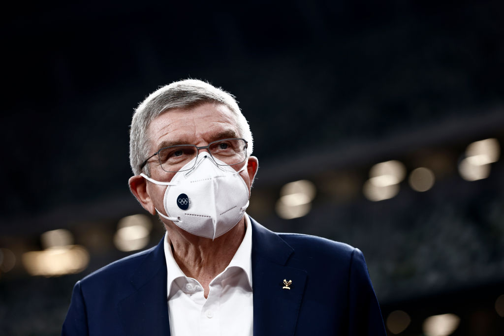 International Olympic Committee President Thomas Bach, wearing a face mask, speaks to the media during a visit to the National Stadium, main venue for the postponed Tokyo 2020 Olympic and Paralympic Games, on November 17, 2020 in Tokyo, Japan.