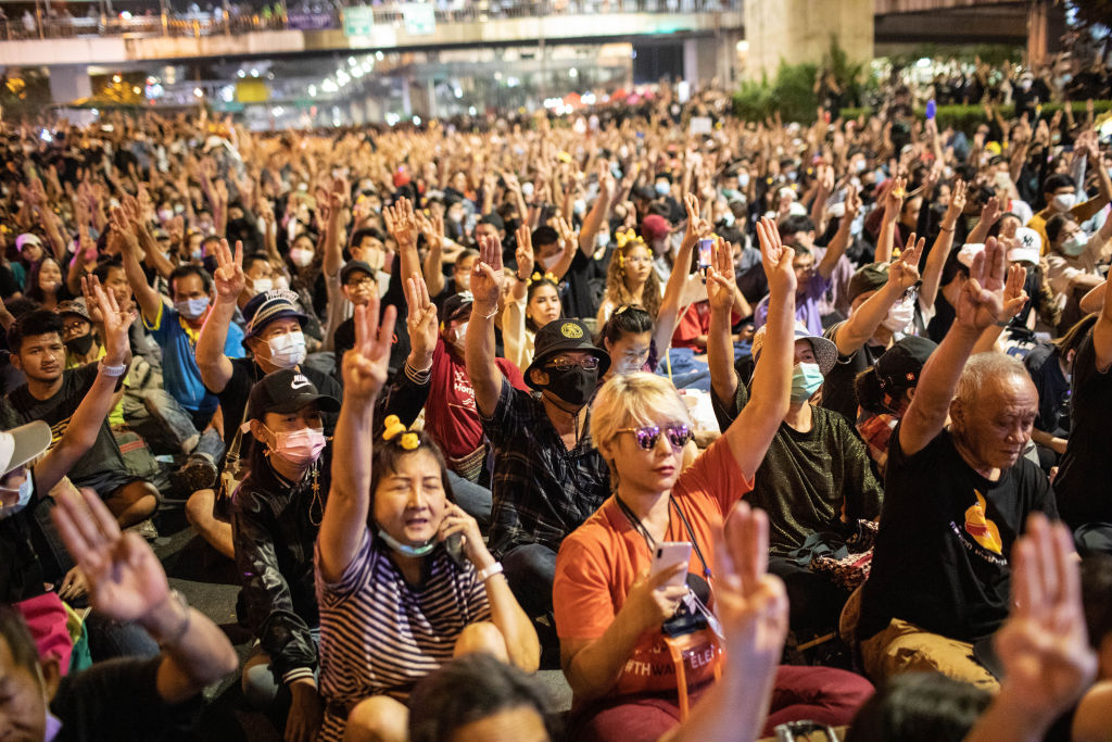 Pro-democracy protesters give the three finger salute during an anti-government demonstration in Bangkok, Thailand on November 27, 2020.