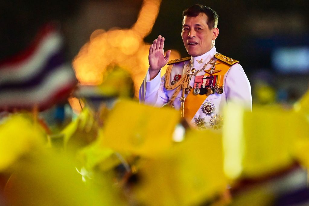 Thailand's King Maha Vajiralongkorn waves to royalist supporters during a ceremony to commemorate the birthday of his father the late Thai king Bhumibol Adulyadej at Sanam Luang in Bangkok on December 5, 2020.