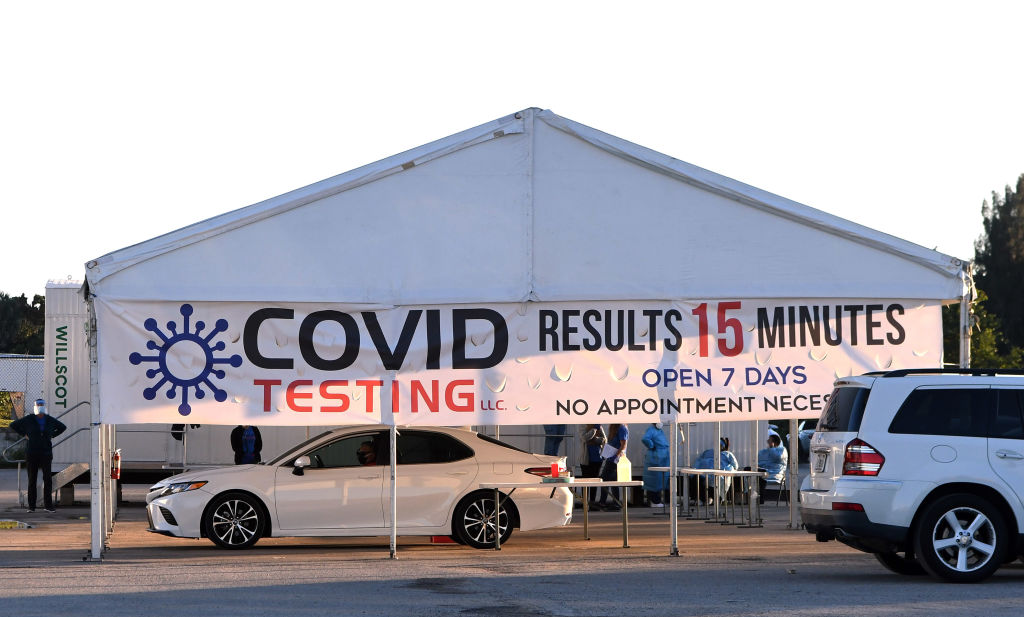 People undergo testing at a rapid COVID-19 test site in Orlando, Fla., on Dec. 8, 2020.