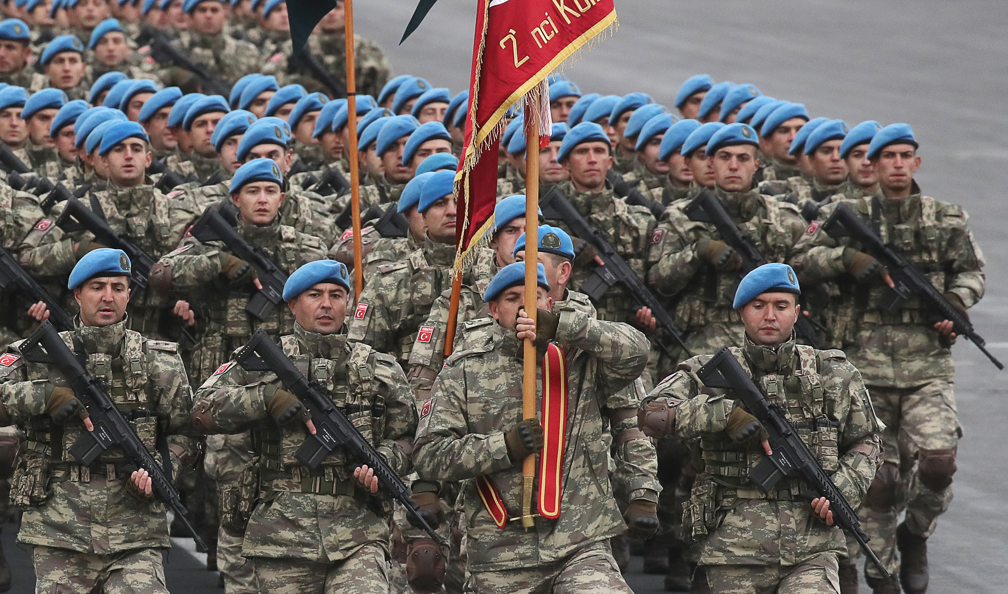 Turkish soldiers march in formation during a military parade marking the end of the Nagorno Karabakh military conflict.