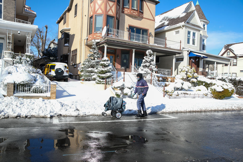 A USPS worker delivers mail in Weehawken, New Jersey on Dec. 17