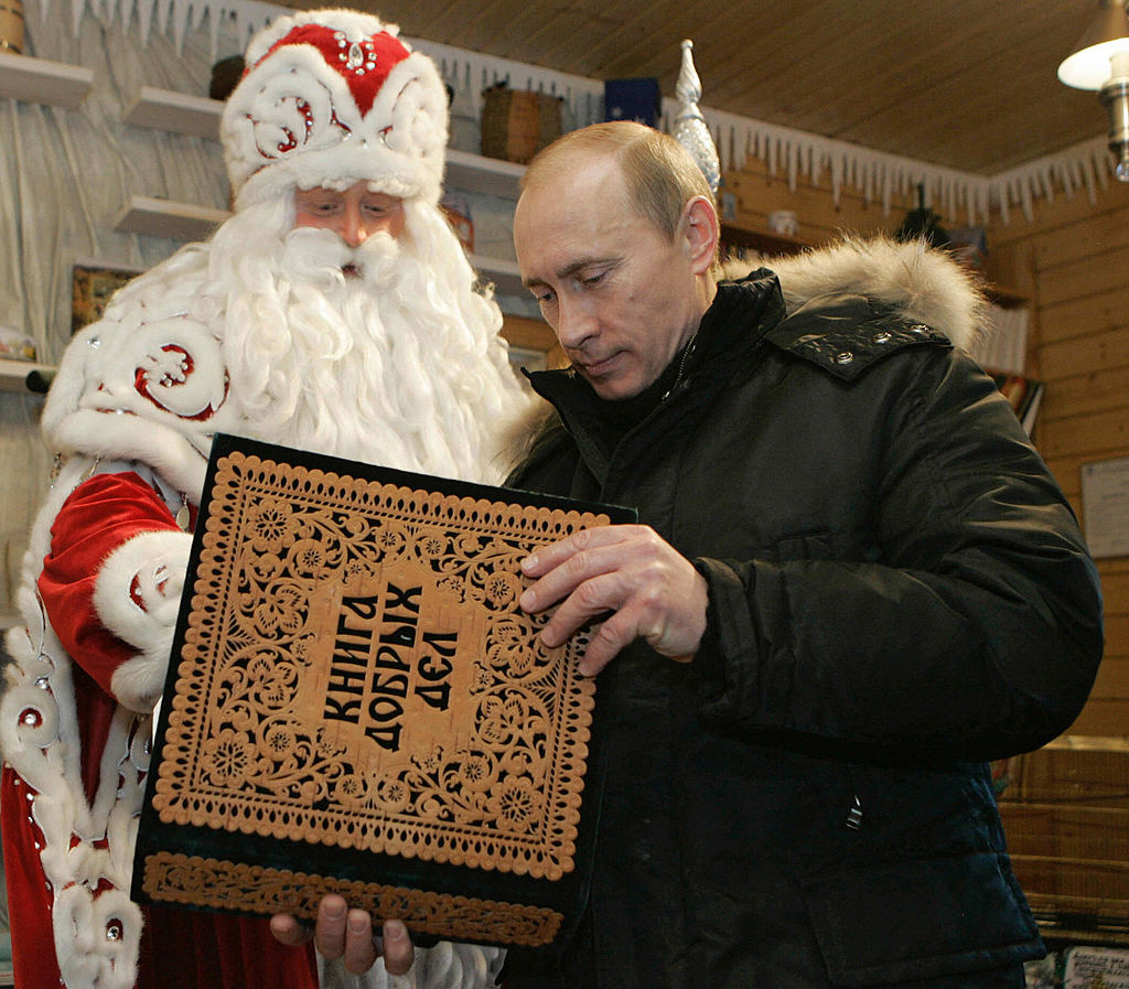 Russian President Vladimir Putin (R) visits the residence of Father Frost, the Russian equivalent of Santa Claus, in the town of Veliky Ustyug, in the Vologda region, about 300 miles north of Moscow, on 7 January 2008.