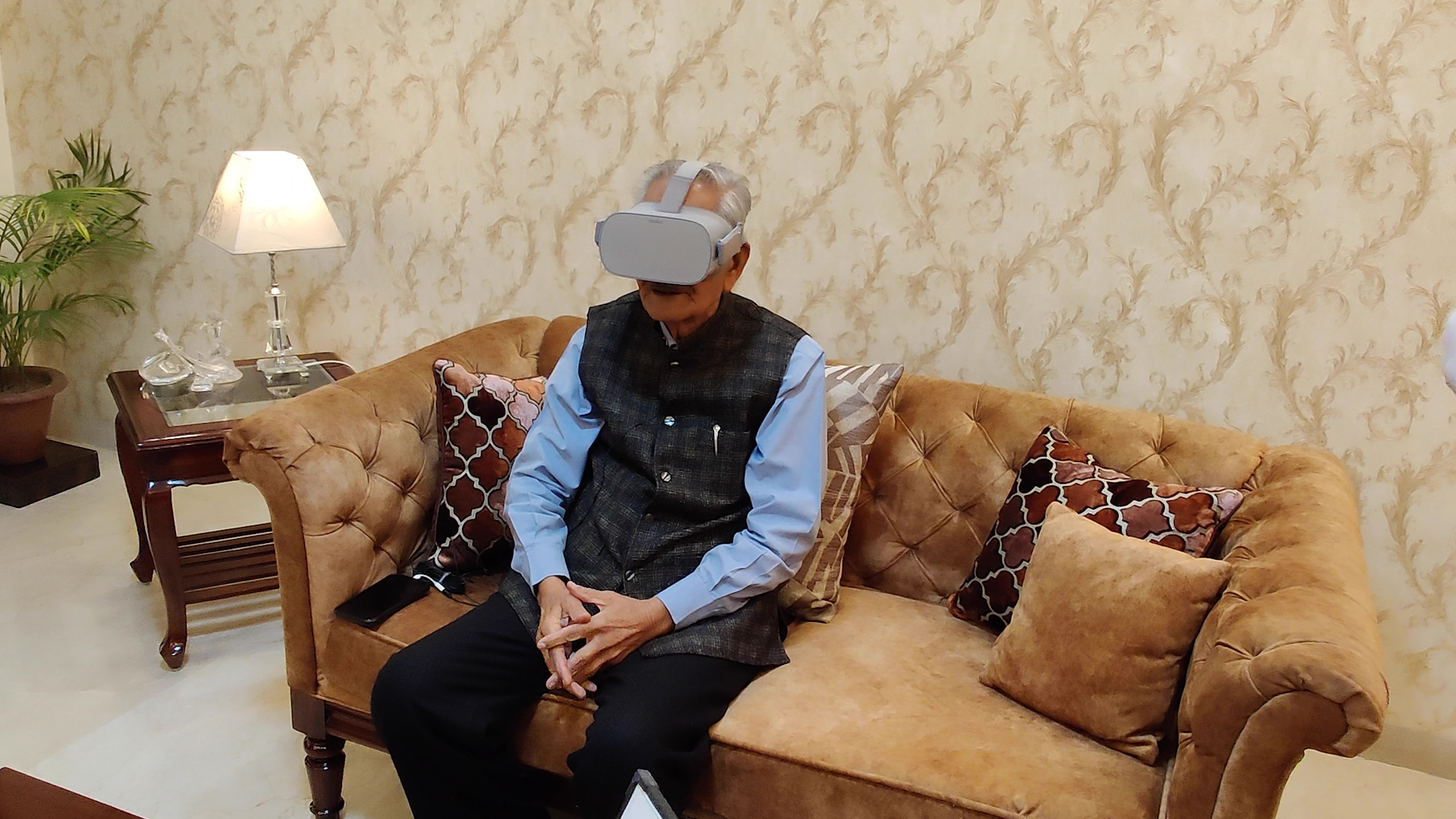 Hari Krishan Lal Anand, 90, wears a virtual reality (VR) headset to tour his hometown in Pakistan, which he fled during the Partition of British India. Anand was able to see his village for the first time in more than 70 years thanks to a VR experience recorded and produced by the nonprofit Project Dastaan.