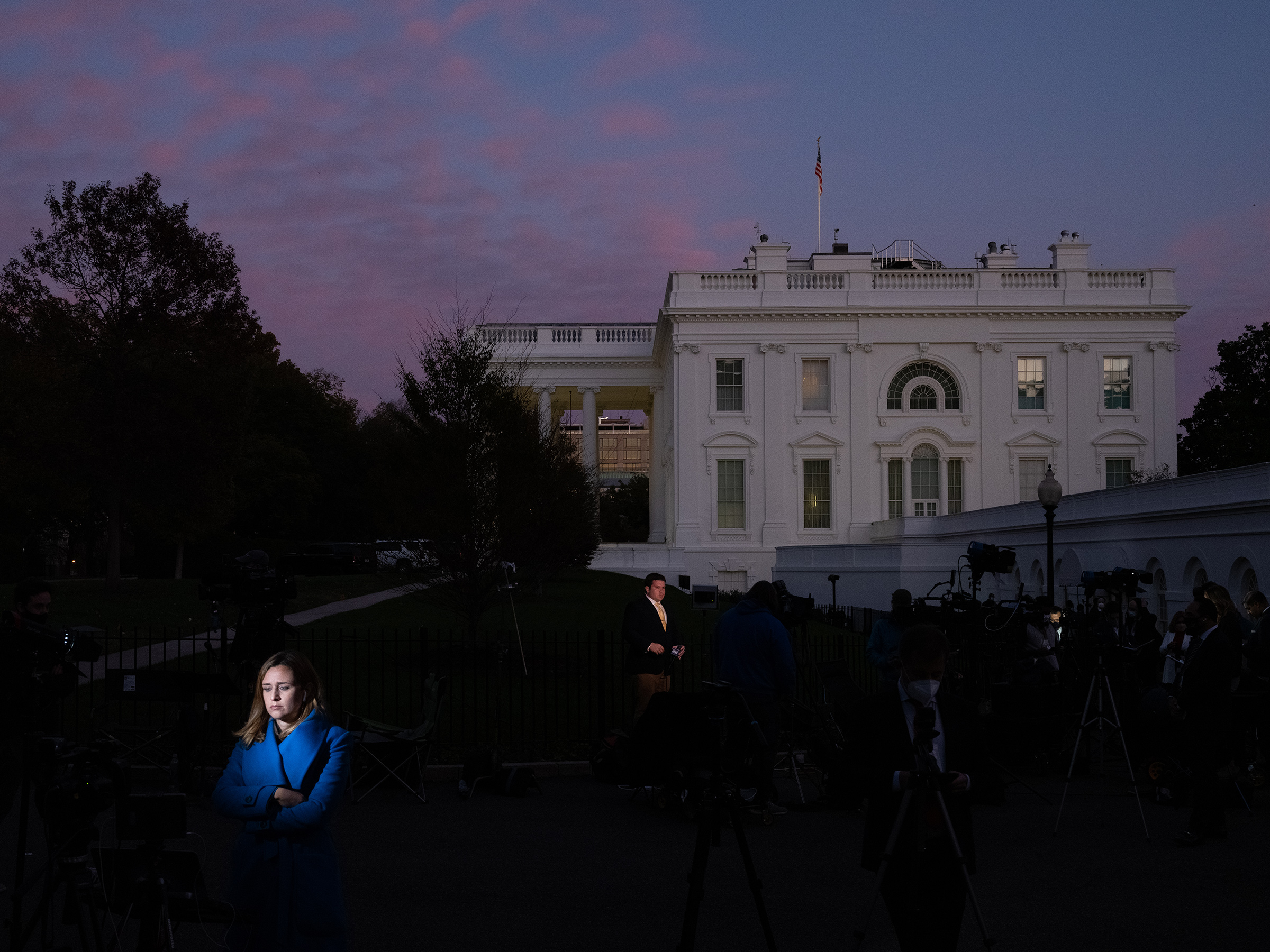 Press near the White House on the eve of the Nov. 3 election in Washington, D.C.