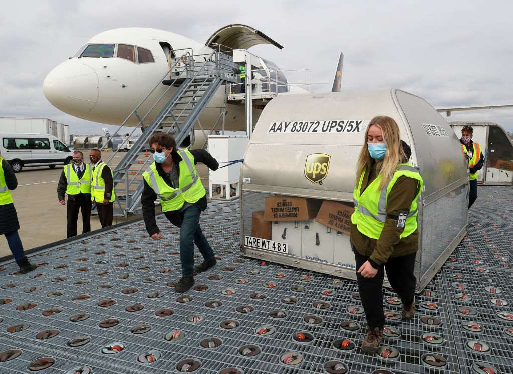 UPS employees move first shipping containers of the Pfizer-BioNTech COVID-19 vaccine in Louisville, Ky. on Dec. 13.