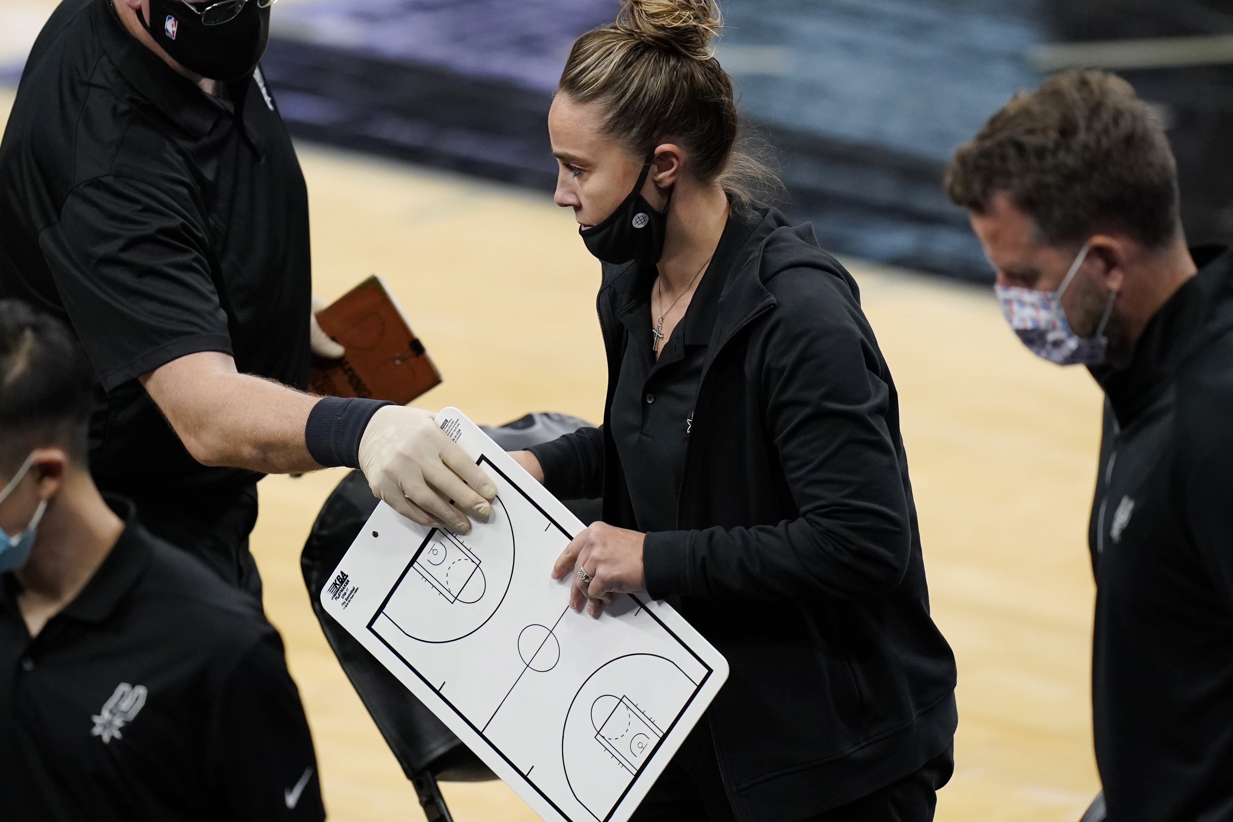 San Antonio Spurs assistant coach Becky Hammon breaks from a huddle during a timeout in the second half of an NBA basketball game against the Los Angeles Lakers in San Antonio, Wednesday, Dec. 30, 2020.