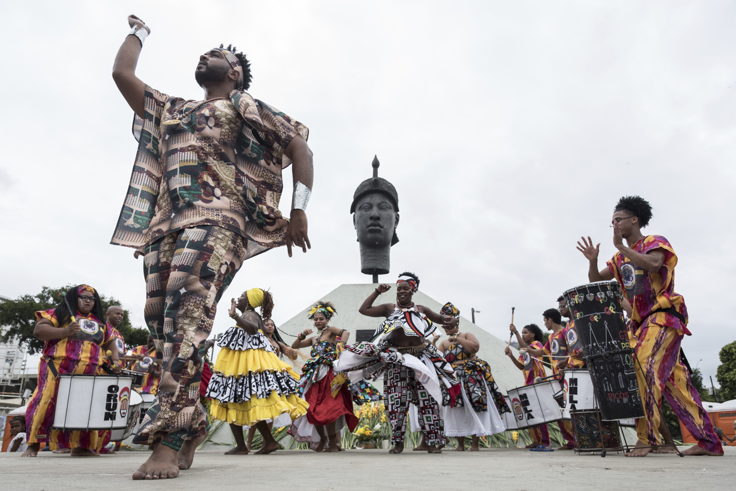 A man dances at a Black Awareness Day event in front of the monument honoring Zumbi dos Palmares, quilombo leader and symbol of the fight against slavery in Brazil, in Rio de Janeiro on Nov. 20, 2019.