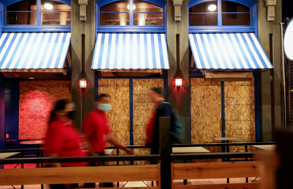 Boarded-up shops along 5th Avenue in the Gaslamp Quarter before an imposed curfew on November 21, 2020 in San Diego, California.