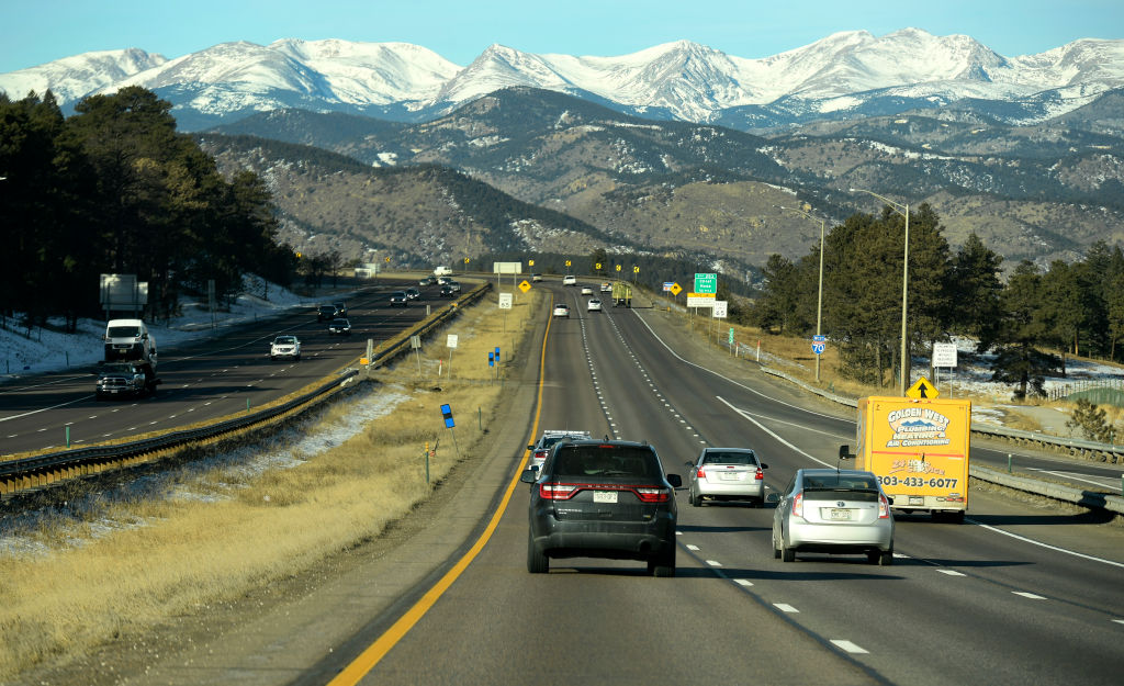 A convoy of vehicles, one containing the COVID-19 vaccines, led by Colorado State Patrol officers, makes its way west on I-70 heading to Vail on Dec. 8, 2020 in Denver, Colorado.