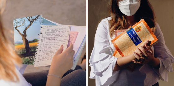 Hannah Kim holds her mother's cookbook that is filled with handwritten notes and recipes; Kim holds her father's favorite books