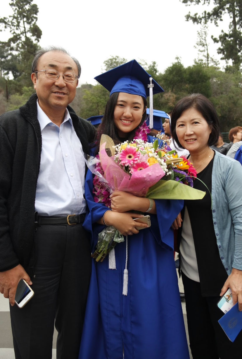 Kim with her parents in 2016.