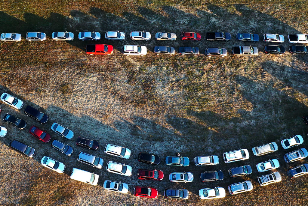 In this aerial view from a drone, people line up in their cars to receive food assistance at the Share Your Christmas food distribution event sponsored by the Second Harvest Food Bank of Central Florida, Faith Neighborhood Center and WESH 2 at Hope International Church in Groveland, Fla., on Dec. 9, 2020.