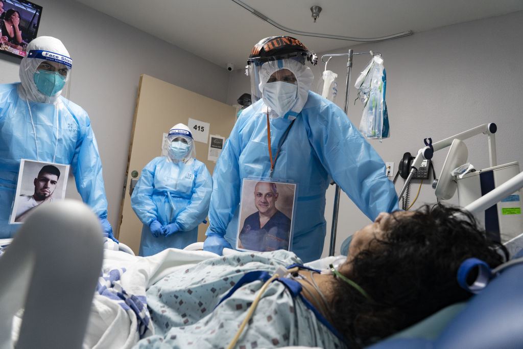 Medical staff members check on a patient at the COVID-19 Intensive Care Unit (ICU) of United Memorial Medical Center in Houston, Texas, on Nov. 8, 2020.