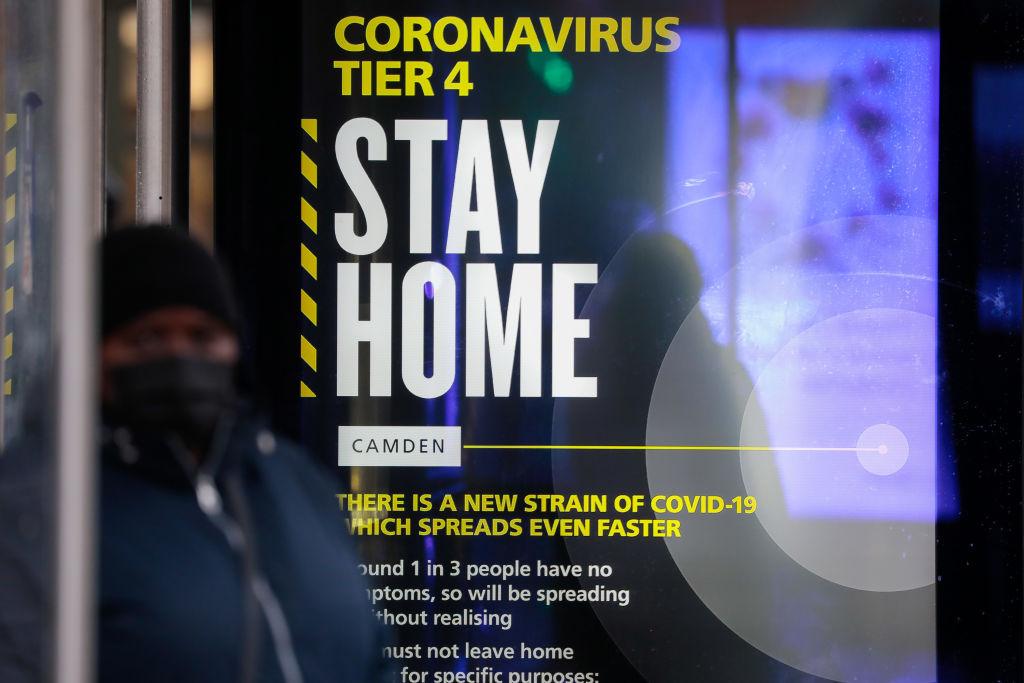 A Coronavirus Tier 4 Stay Home poster near King's Cross railway station in London, U.K., on Monday, Dec. 21, 2020.
