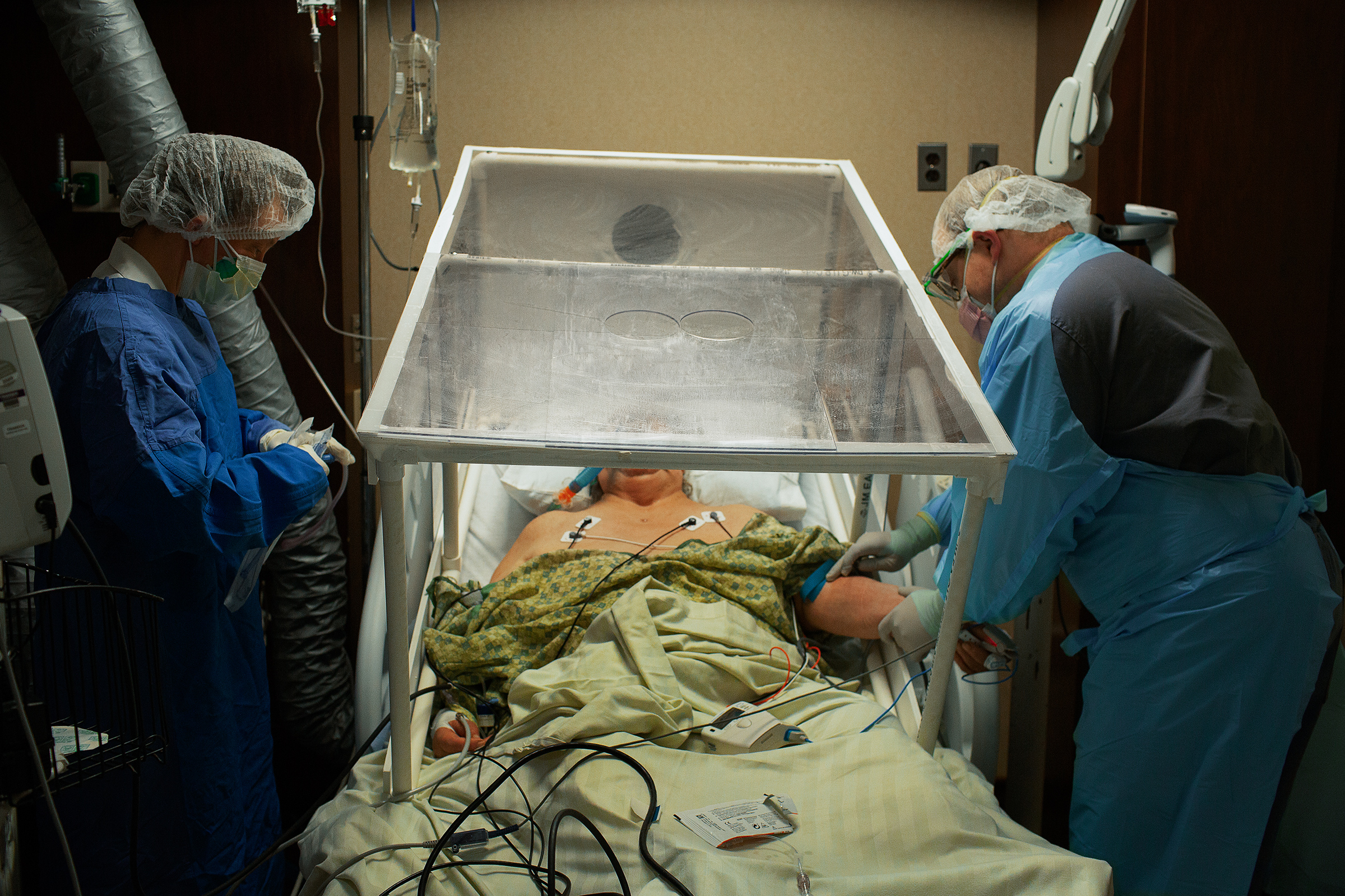 A COVID-19 patient is prepared for intubation by the anesthesiologist at Holy Name Medical Center in Teaneck, N.J., on March 31. The plastic tent is so the virus isn't spread while transporting the patient between units.