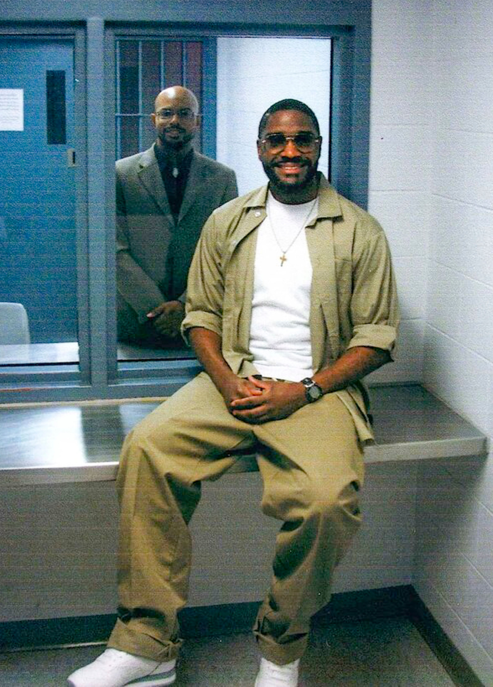 Federal inmate Brandon Bernard, right, with Pastor Aaron Chancy, left, as Bernard as he waited his scheduled execution in Terre Haute, Ind. Bernard was executed on Dec. 10.