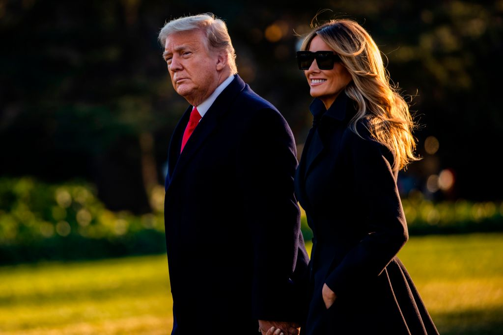 President Donald Trump and First Lady Melania Trump walk towards Marine One as they depart the White House en route to Mar-a-Lago, the President's private club, where they will spend Christmas and New Years Eve in Washington, DC on Dec. 23, 2020.