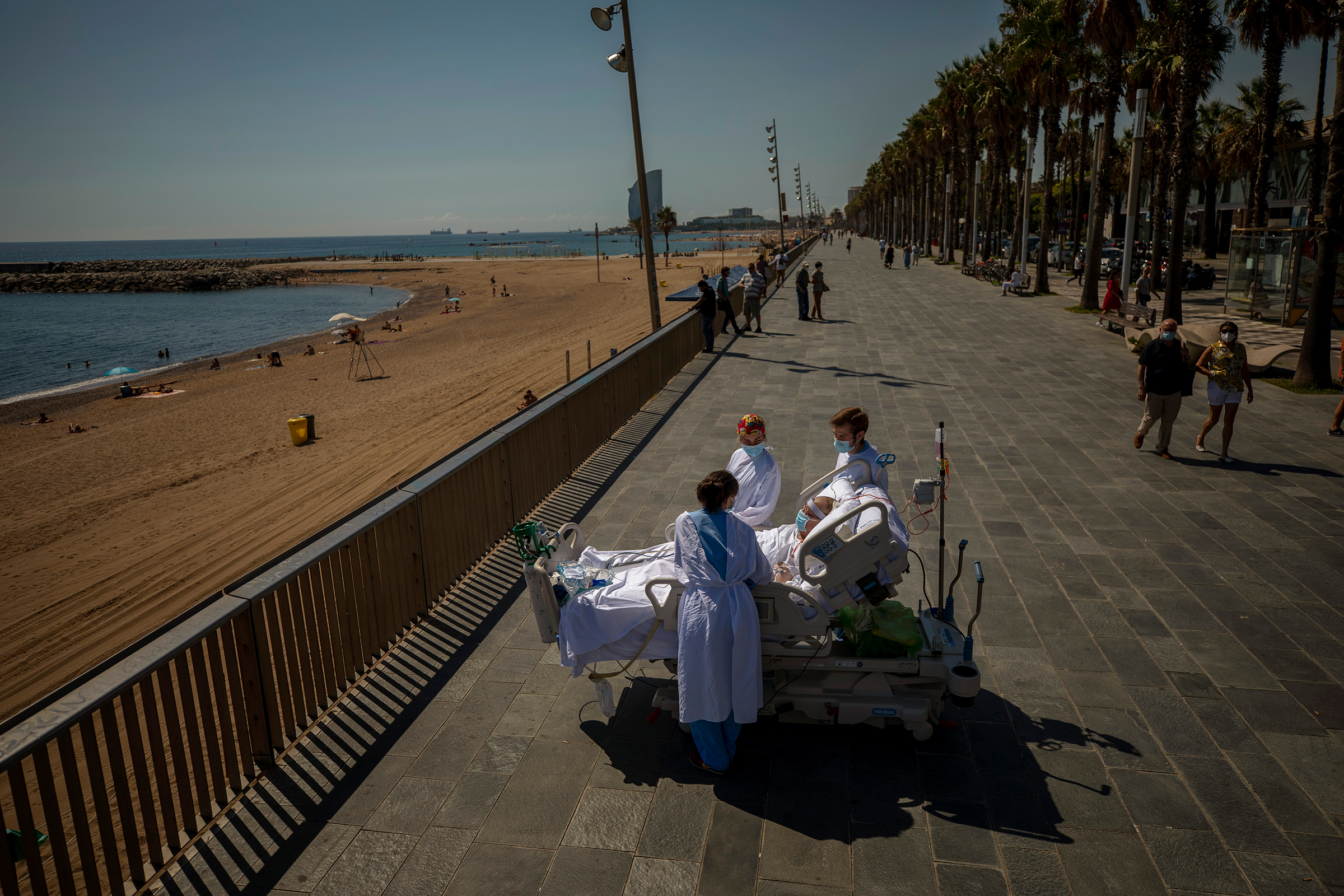 Francisco Espana, 60, is surrounded by members of his medical team on a promenade next to the Hospital del Mar in Barcelona on Sept. 4.