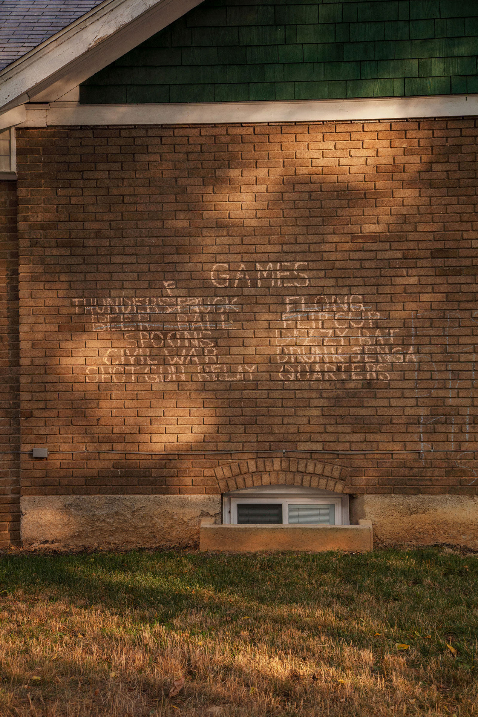 A list of drinking games on the side of a house in State College, Pa. The typically bustling main campus of Pennsylvania State University was quieter than normal.
