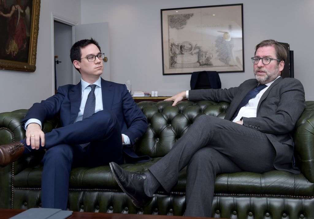 President Fabien Lehagre, left, and lawyer Patrice Spinosi of 'Association des Americains Accidentels' (AAA) are pictured during an interview with AFP in Paris on December 7, 2017.