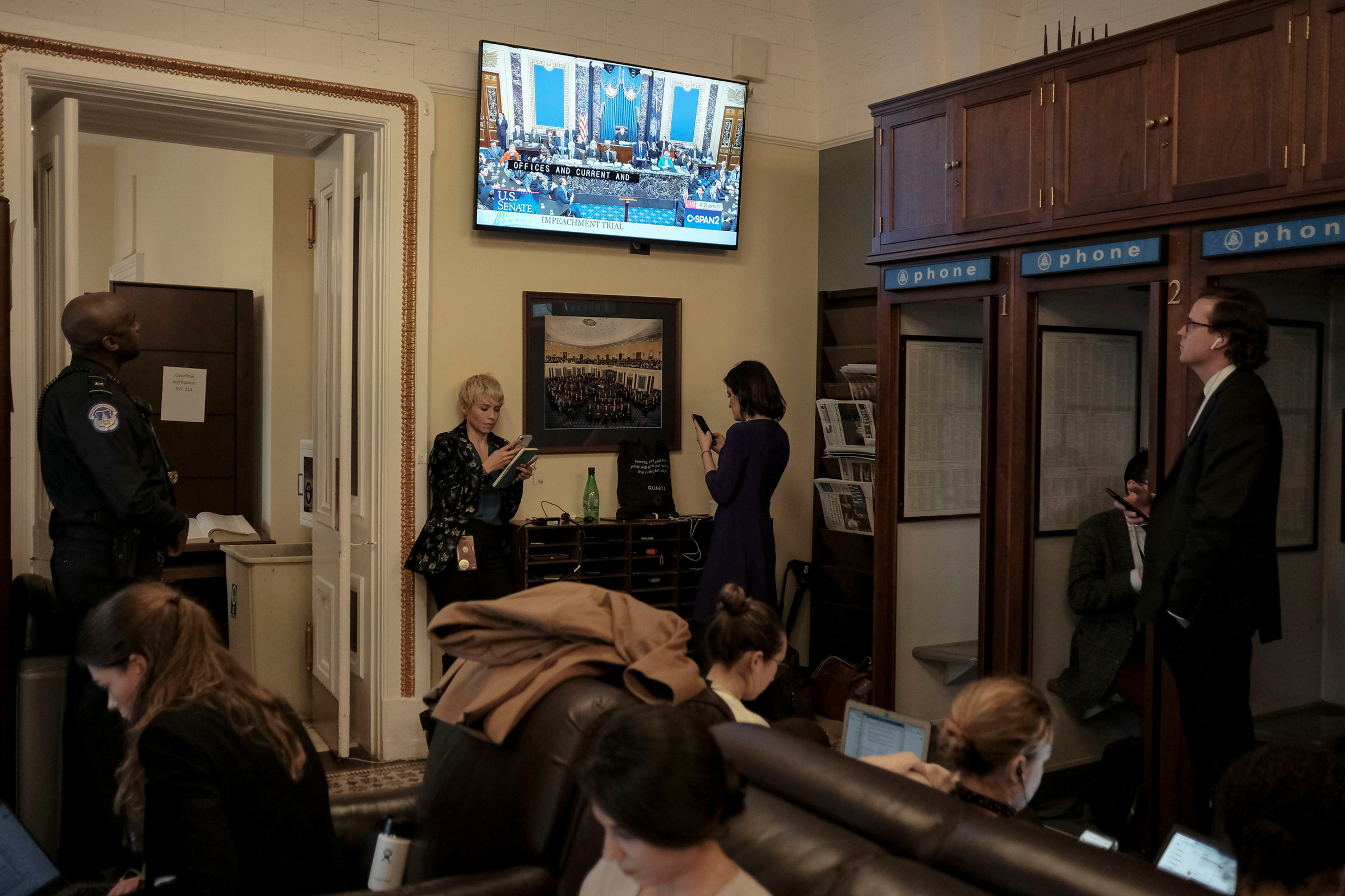 Reporters watch the Senate impeachment vote in the press gallery at the Capitol in Washington, D.C., on Feb. 5.