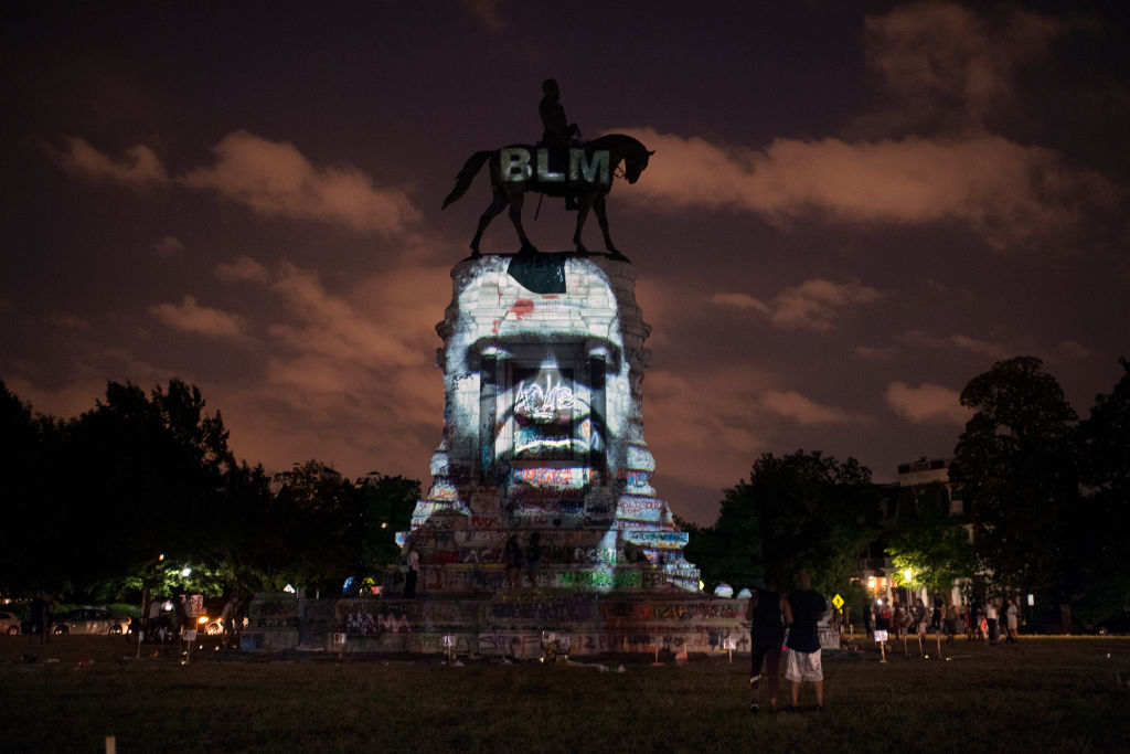 The image of George Floyd along with the Black Lives Matter letters are projected onto the Robert E. Lee Statue on Monument Avenue in Richmond, Virginia, on June 10, 2020.