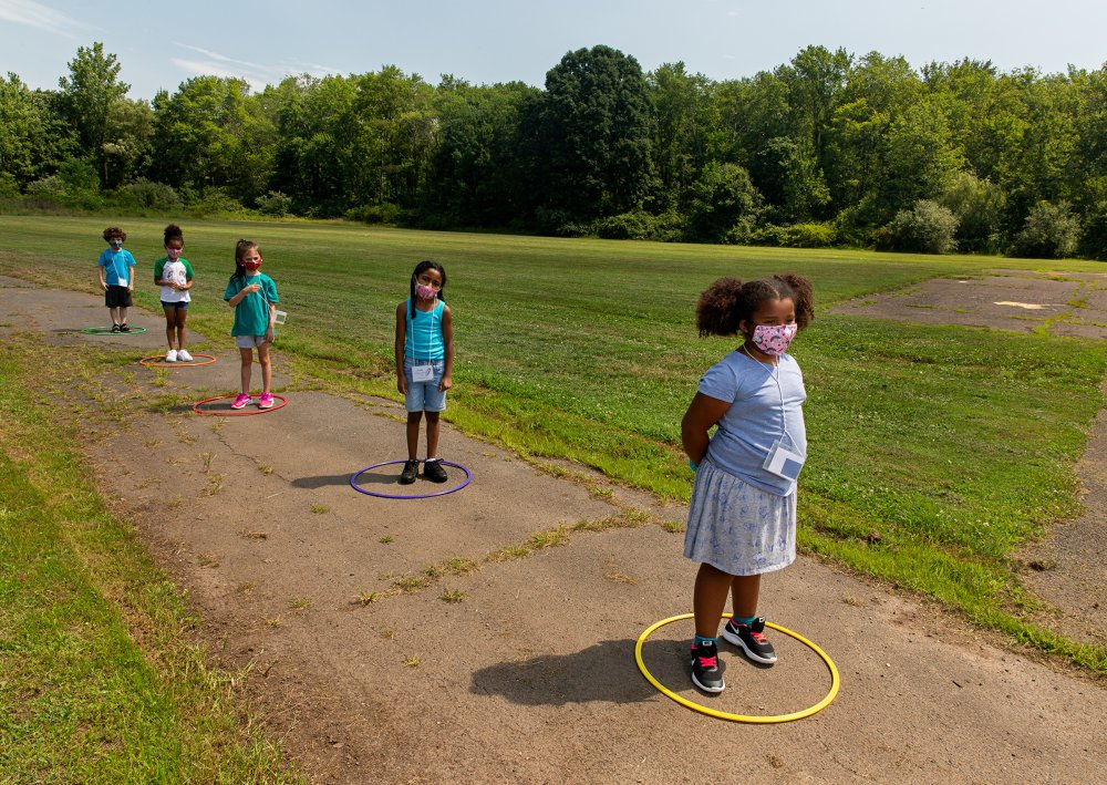 Children line up for school at Wesley Elementary in Middle­town, Conn., on July 20.