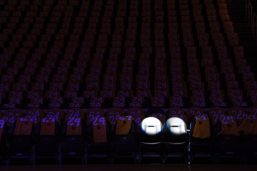The Los Angeles Lakers honor Kobe Bryant and daughter Gigi—two of nine people who died in a helicopter crash—by spotlighting two empty court-side seats at the Staples Center on Jan. 31.