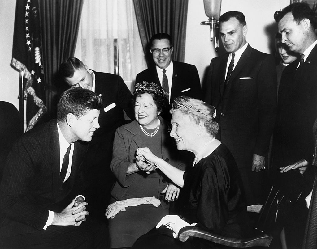 Helen Keller (seated, right) visits President John F. Kennedy (seated, left) at the White House on April 8, 1961.