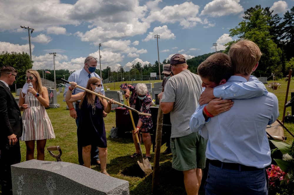 The family and friends of Jefrey Scott Cameron, who died of an accidental overdose earlier this year, at his burial in Barre, Vt., on July 18. By this time, more than 40 states had seen increases in overdoses since the onset of the pandemic in the U.S.