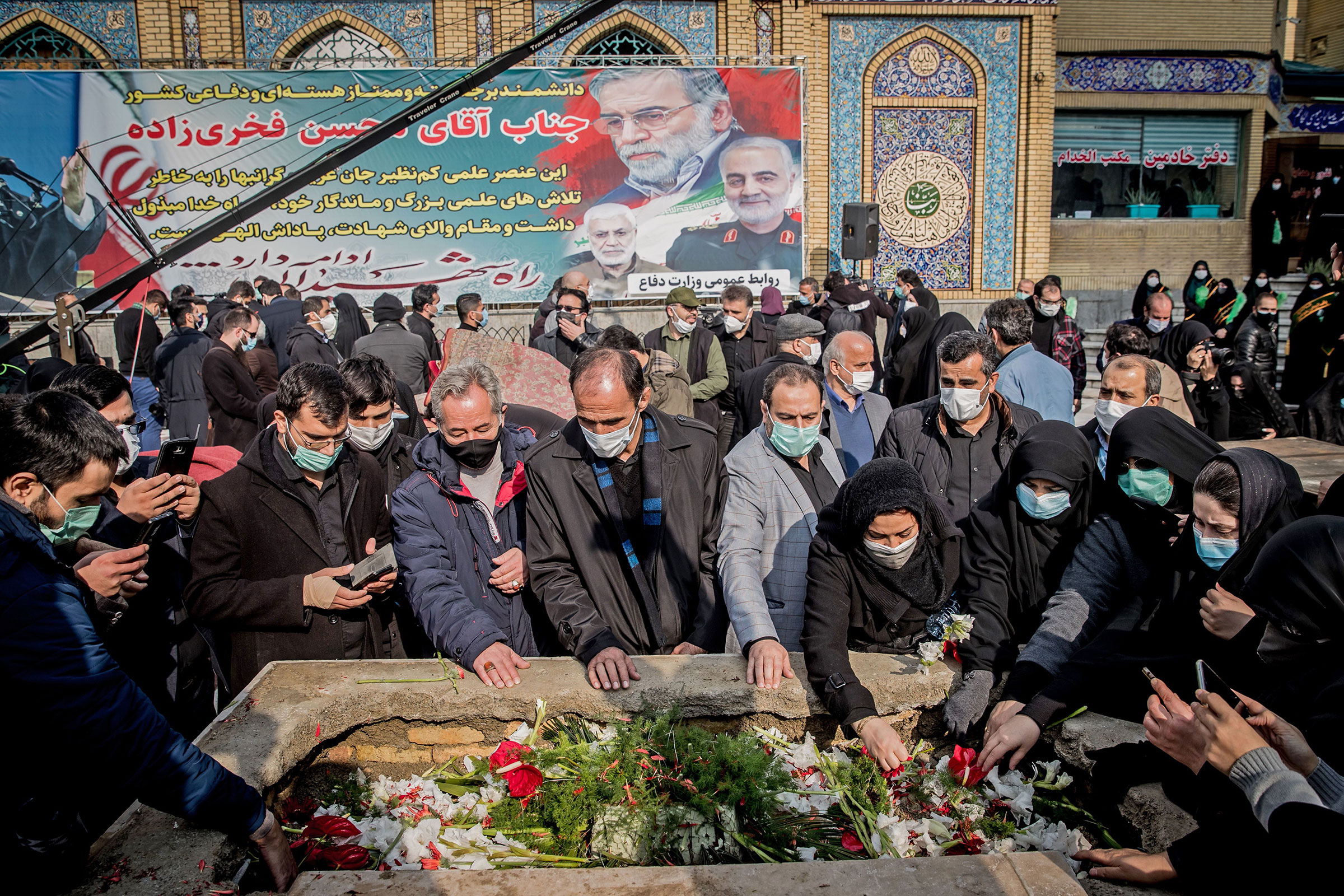 Iranian mourners attend the burial ceremony of slain nuclear scientist Mohsen Fakhrizadeh at Imamzadeh Saleh shrine in northern Tehran, on Nov. 30, 2020.