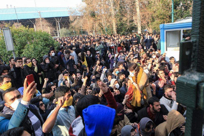 In this Saturday, Dec. 30, 2017 file photo, university students attend a protest inside Tehran University in Iran. A channel on a mobile messaging app run by exiled journalist Roohallah Zam helped fan the passions of some of those who took to the street. Zam was kidnapped by Iranian operatives—apparently from neighboring Iraq—imprisoned and then hanged on Dec. 12, 2020.