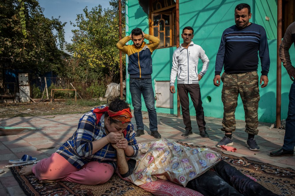 Fuad Izmayilov's sister kisses his hand shortly after he was killed in a rocket attack launched by Armenian forces on the city of Barda, Azerbaijan, on Oct. 28.