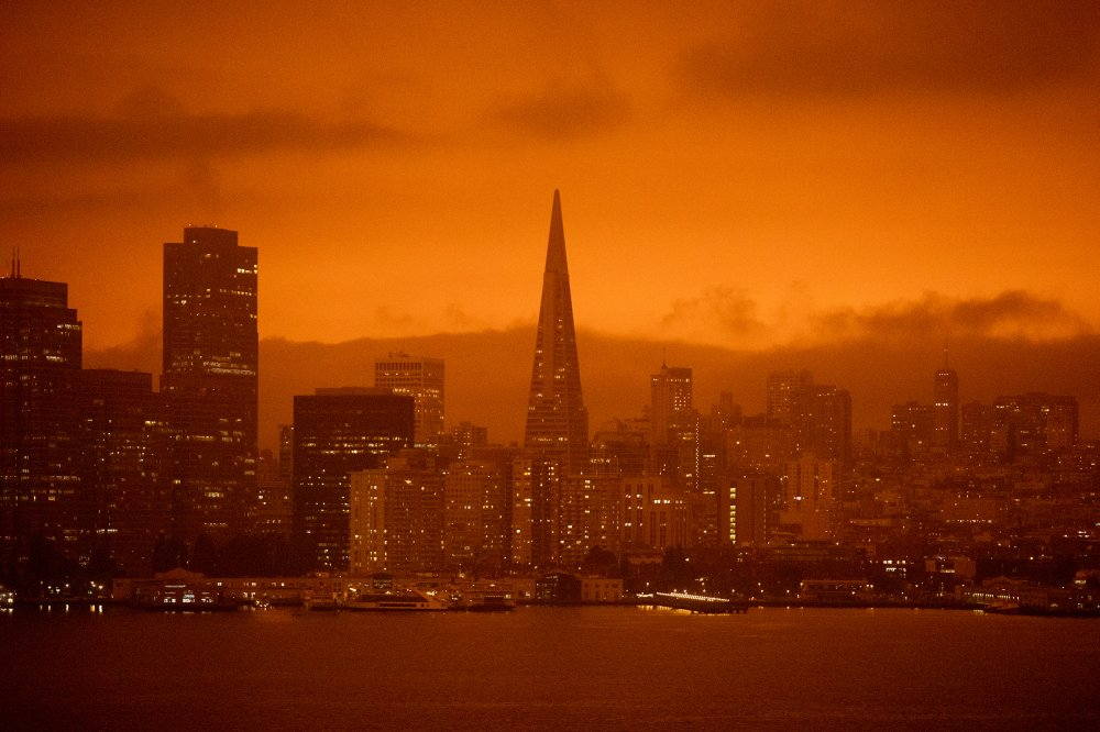 Dark orange skies hang over the San Francisco skyline, as seen from Treasure Island, on Sept. 9, due to multiple wildfires burning across California and Oregon.