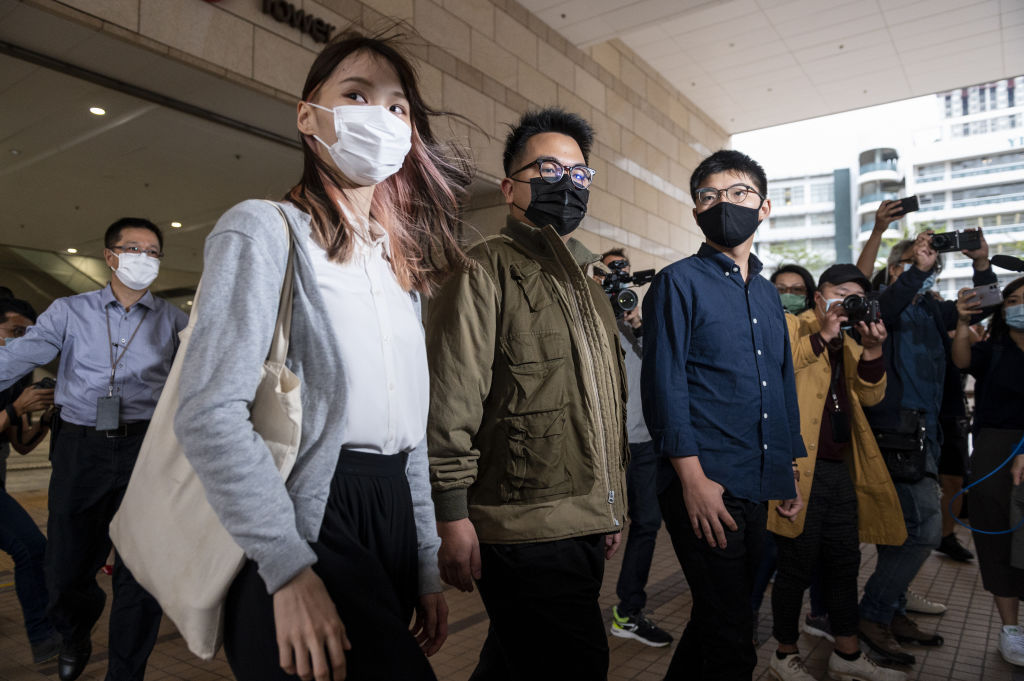 Agnes Chow (L), Ivan Lam (C), and Joshua Wong (R) arrive at the West Kowloon Law Courts building on Nov. 23, 2020 in Hong Kong.