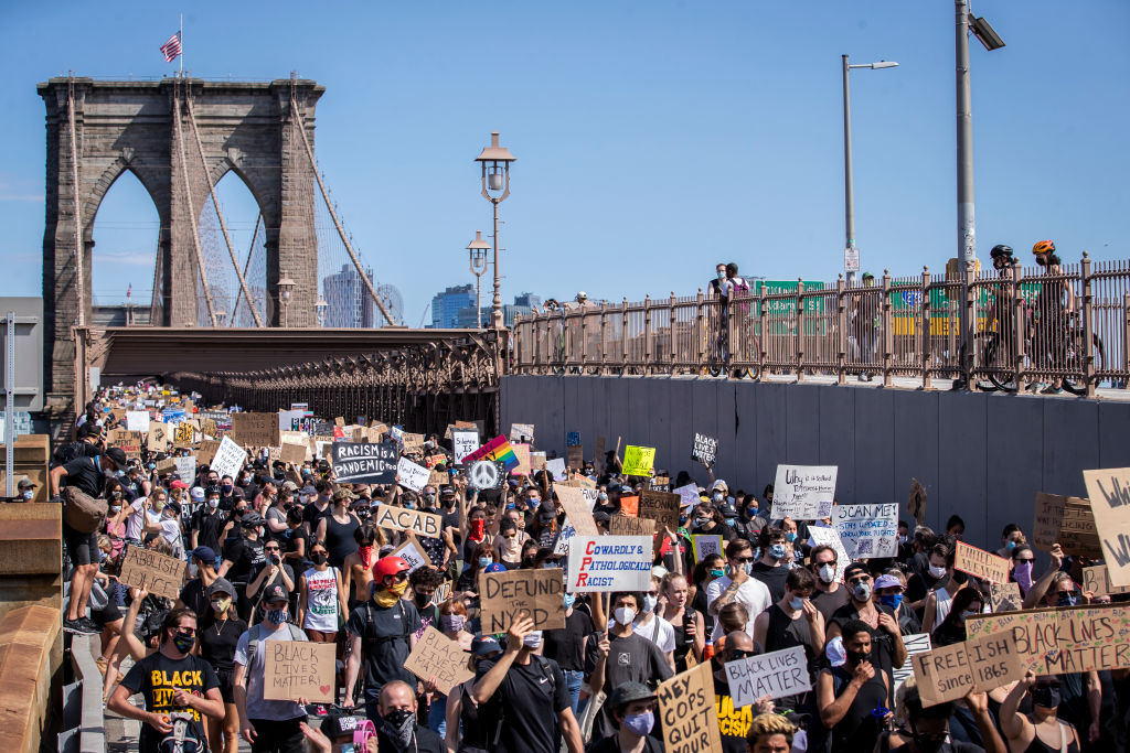 Thousands of protesters walk across the Brooklyn Bridge on  Juneteenth,  June 19, 2020, as part of one of the many protests against police brutality and in support of the Black Lives Matter movement that have taken place in 2020.