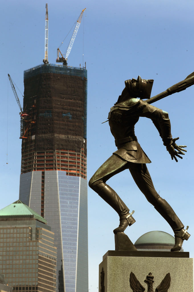 The Katyn monument is seen in Exchange Place as construction continues on One World Trade Center in the distance, on April 30, 2012, as seen from Jersey City, N.J.