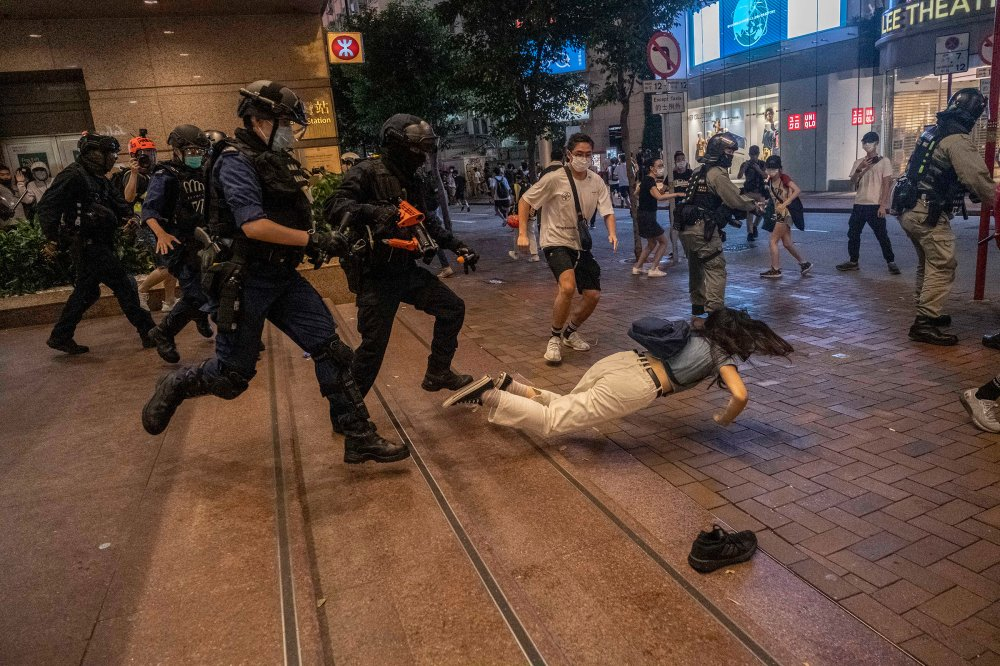Police clash with protesters in Hong Kong on July 1, one day after a new national security law went into effect. The city immediately felt the chilling effect of Beijing's offensive to quash dissent in the semiautonomous territory.