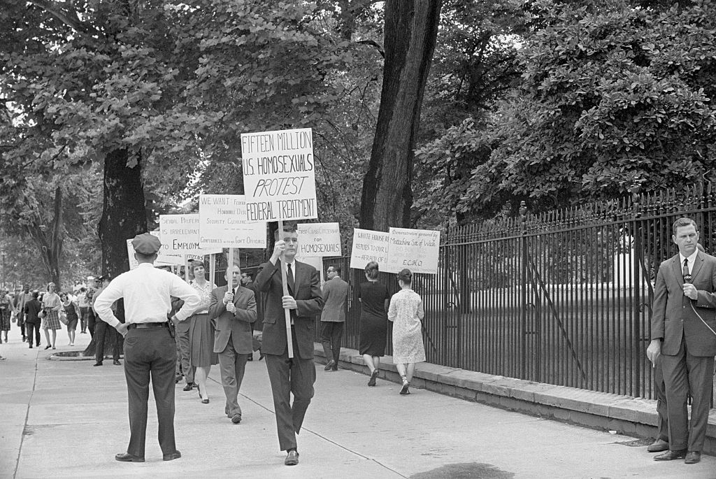 Protesters, one with a sign that reads  Fifteen million U.S. homosexuals protest federal treatment,  demonstrate outside the White House on Armed Forces Day, on May 21, 1965.