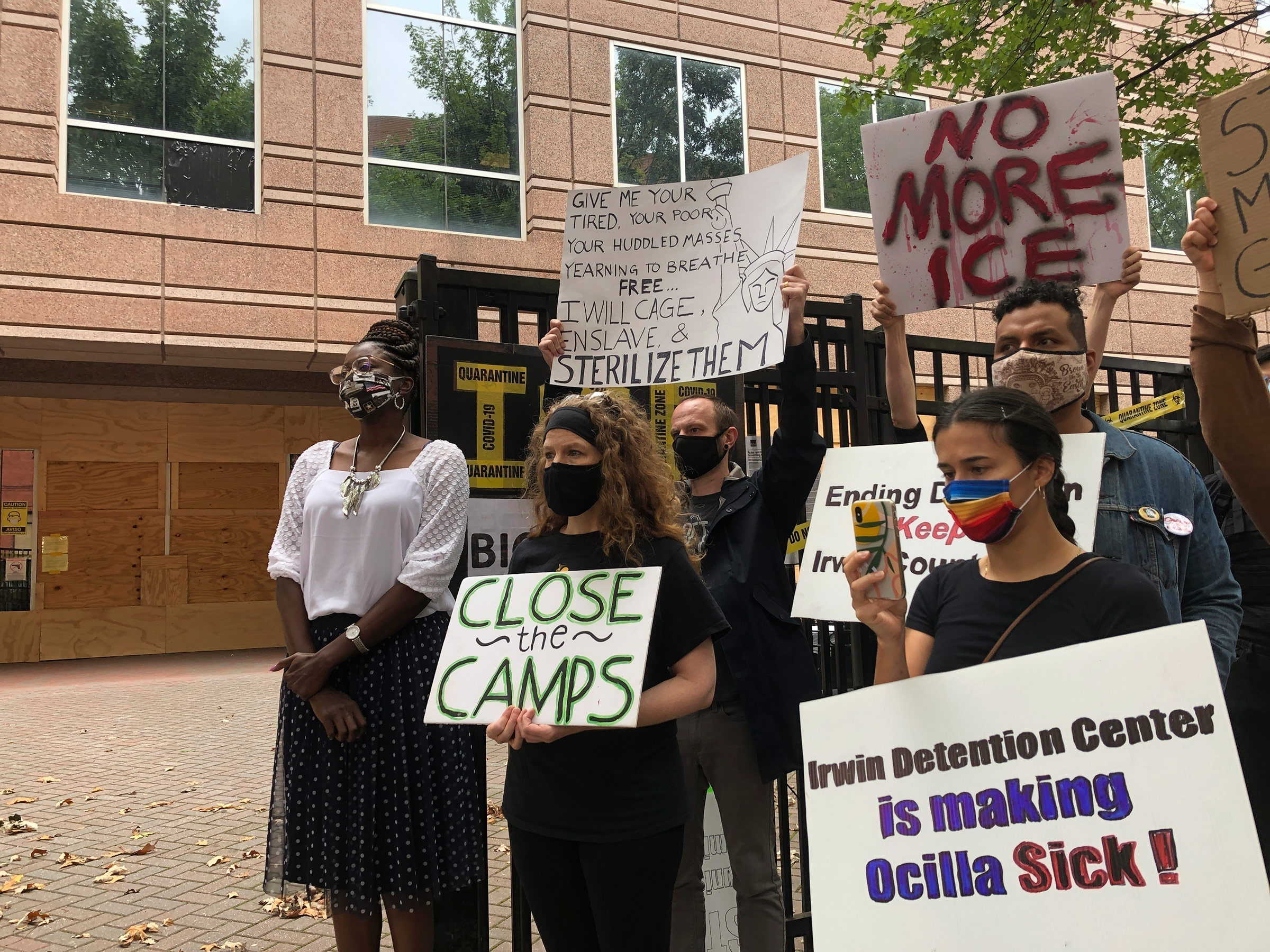 Dawn Wooten, left, a nurse at Irwin County Detention Center in Ocilla, Ga., speaks at a news conference in Atlanta protesting conditions at the immigration jail, on Sept. 15.