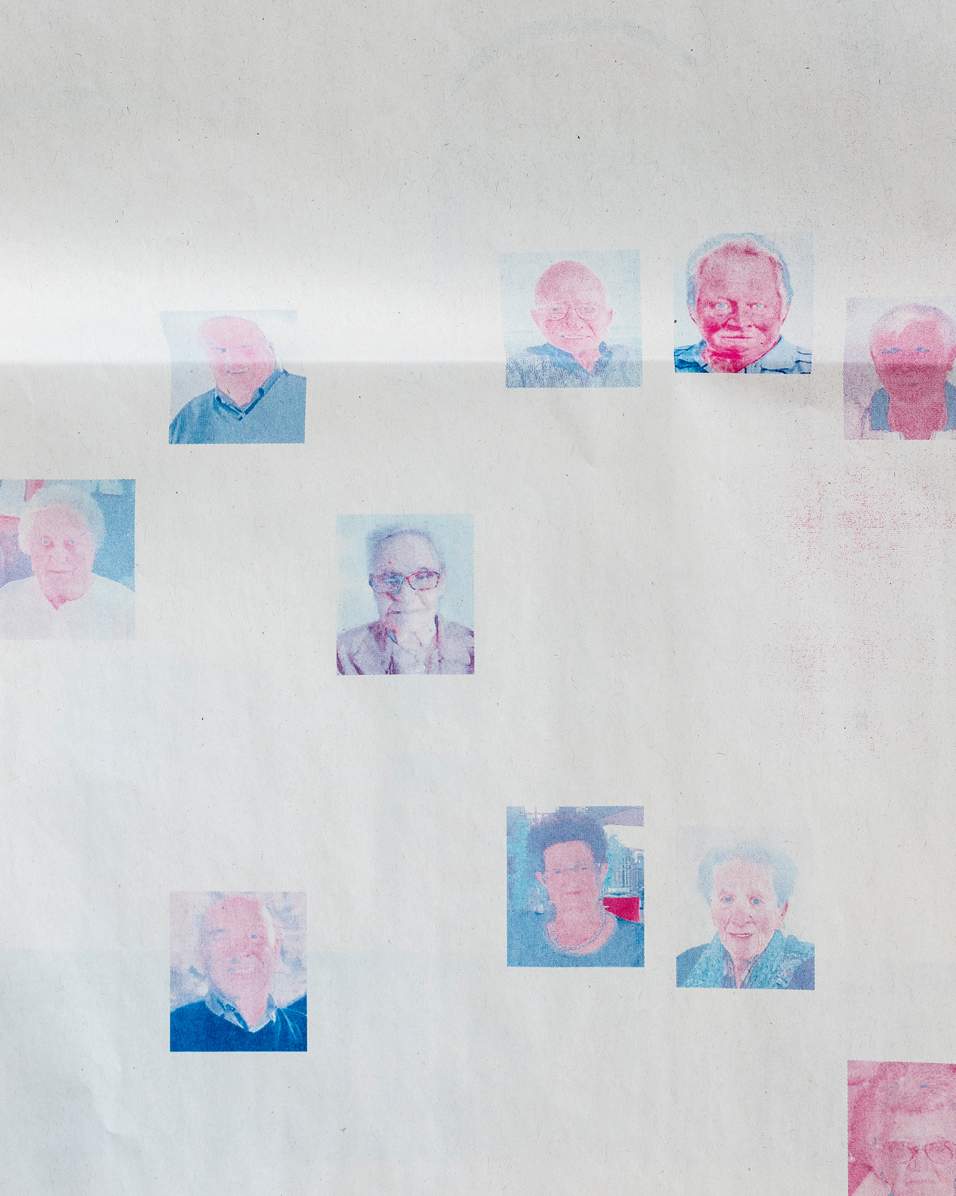 Discolored obituary portraits at the printing plant of L'Eco diBergamo in Erbusco; the newspaper dedicated more pages to accommodate the death toll.