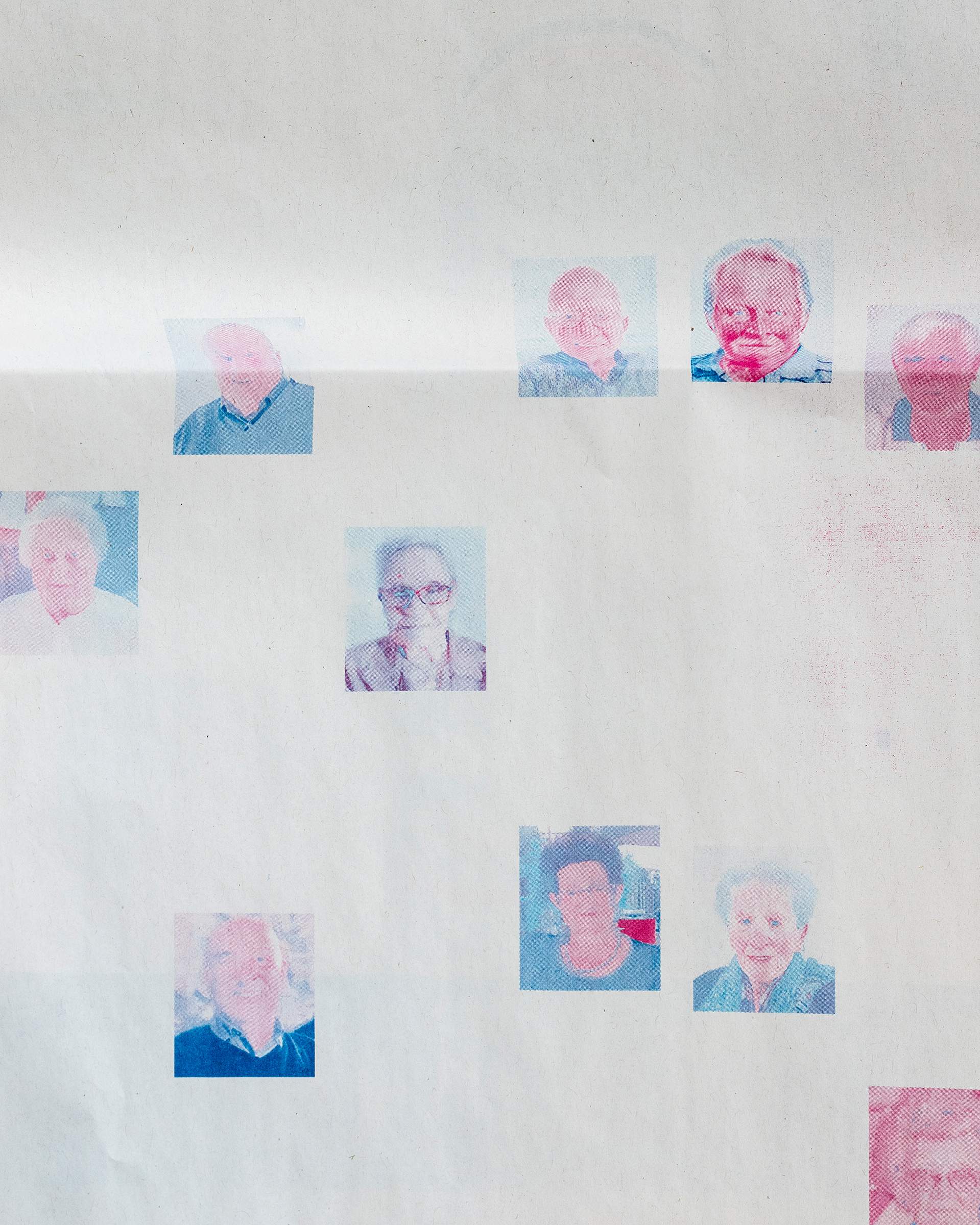 Discolored obituary portraits at the printing plant of L'Eco di Bergamo in Erbusco in April; the newspaper dedicated more pages to accommodate the COVID-19 death toll.