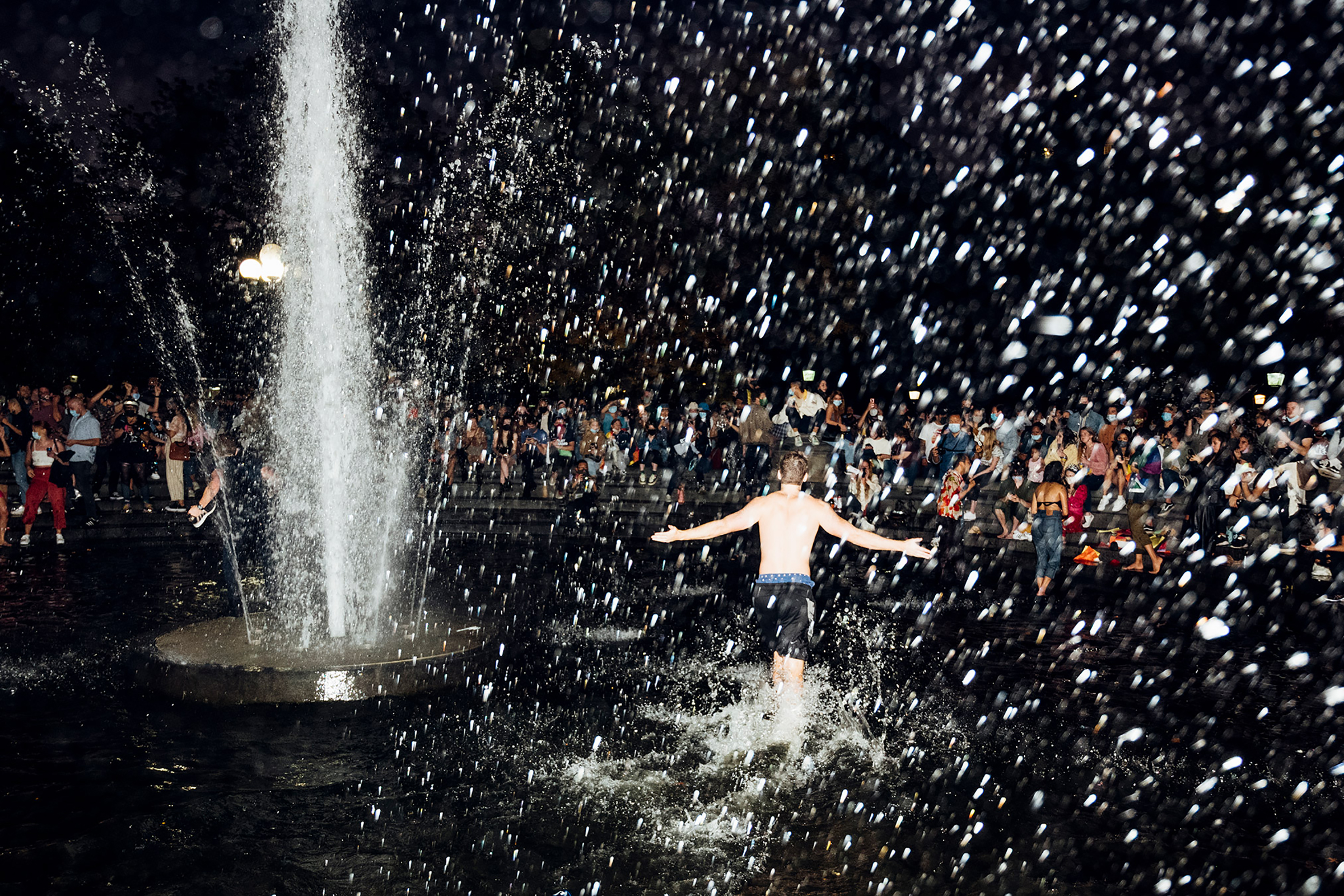 A man runs through the fountain in Washington Square Park in New York City on Nov. 7, after Joe Biden was declared the winner of the 2020 U.S. presidential election.